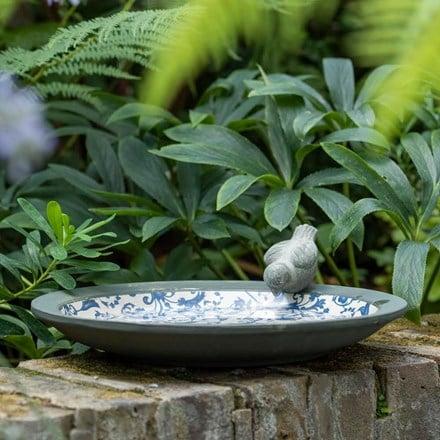 Aged ceramic bird bath